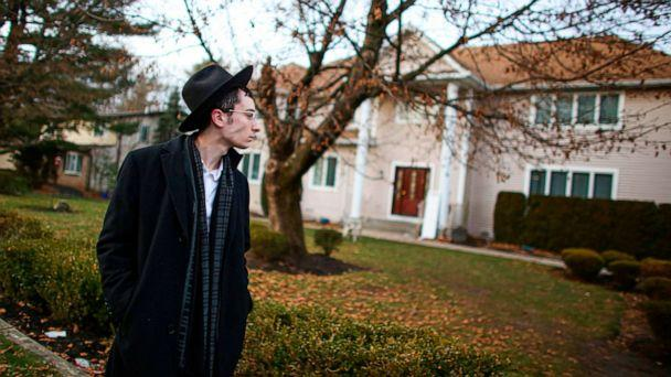 PHOTO: A man stands outside the home of rabbi, Chaim Rottenberg in Monsey, N.Y., Dec. 29, 2019, after an attack that took place earlier outside the rabbi's home during the Jewish festival of Hanukkah. (Kena Betancur/AFP/Getty Images)