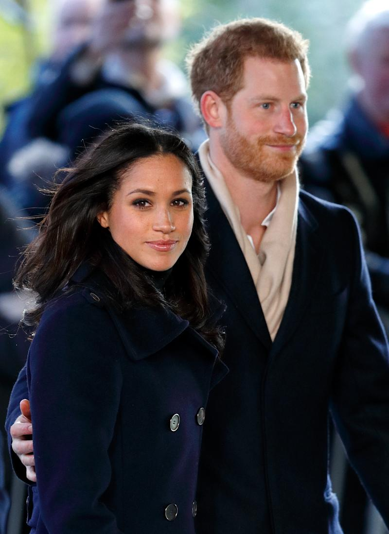 Prince Harry and Meghan Markle on an official visit wearing black coats