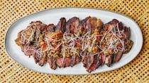 """""""This dish has all the elements I am looking for in a recipe. A punchy flavorful sauce that is tangy, spicy, and fresh, topped over a perfectly grilled steak, eaten as is or with some crunchy lettuce. It's perfect for summer entertaining!"""" <em>—Rachel Gurjar, associate food editor</em> <a href=""""https://www.bonappetit.com/recipe/tri-tip-steak-with-tiger-bite-sauce?mbid=synd_yahoo_rss"""" rel=""""nofollow noopener"""" target=""""_blank"""" data-ylk=""""slk:See recipe."""" class=""""link rapid-noclick-resp"""">See recipe.</a>"""