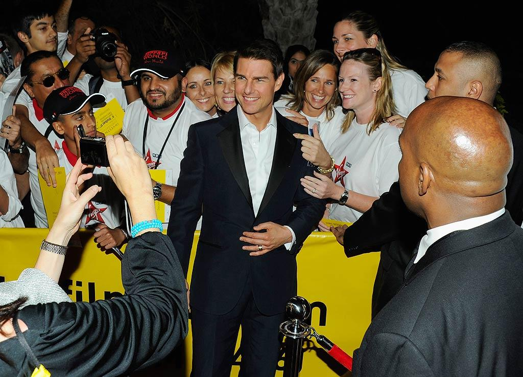 "At age 49, A-list actor Tom Cruise can still draw a crowd -- even halfway around the world! Tom created quite a stir as he posed with fans at Wednesday's premiere of  ""Mission: Impossible - Ghost Protocol"" during the first day of the 8th Annual Dubai International Film Festival. (12/7/2011)"