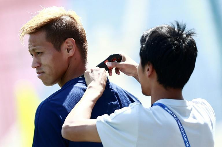Japan midfielder Keisuke Honda has a GPS tracker device fitted during training at the 2018 World Cup in Russia. Connected devices are increasingly shaping the workouts of professional athletes