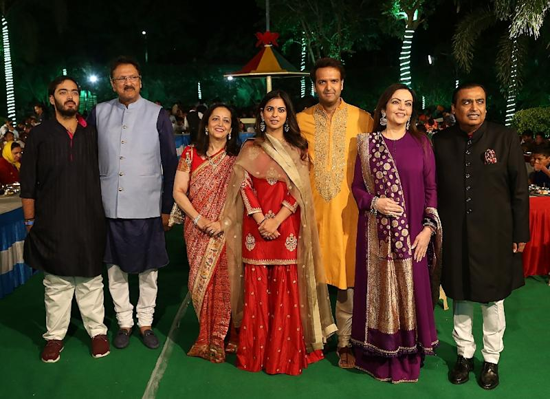 The respective families will hold several other receptions across India's financial capital in the coming days (AFP Photo/Handout)