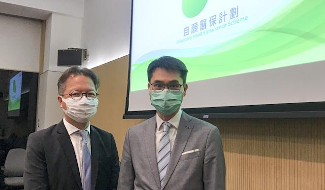 Insurance scheme head Derek Lee (left) and food and health official Fong Ngai attend a media briefing on the scheme on Wednesday. Photo: Elizabeth Cheung