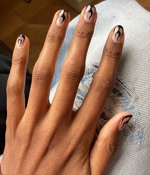 """<p>Just when you thought you'd seen every possible variation of the flame manicure, this one comes in and steals your heart. </p><p><a href=""""https://www.instagram.com/p/CP01wFjtRRD/"""" rel=""""nofollow noopener"""" target=""""_blank"""" data-ylk=""""slk:See the original post on Instagram"""" class=""""link rapid-noclick-resp"""">See the original post on Instagram</a></p>"""