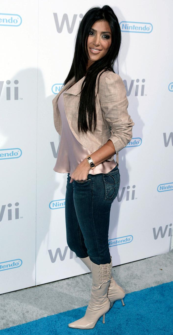 "Stylist Kim Kardashian arrives at the Nintendo ""Wii"" video game console launch party in the Hollywood section of Los Angeles on Thursday, Nov. 16, 2006. (AP Photo/Matt Sayles)"