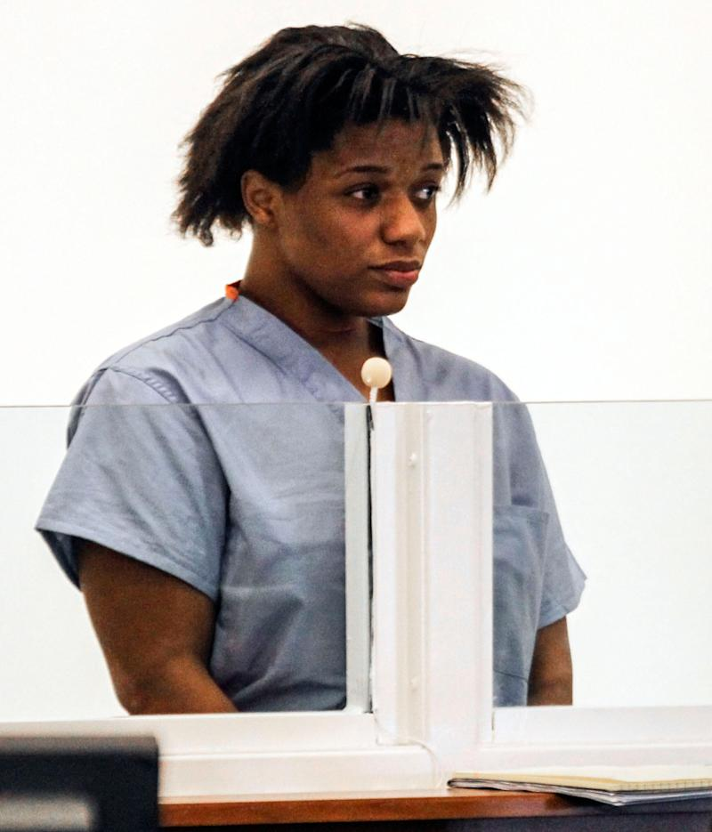 Tanicia Goodwin is arraigned in Salem District Court on 2 counts of armed assault with intent to murder, 2 counts of assault and battery with a dangerous weapon and 1 count of arson on Monday, March 19, 2012 in Salem, Mass. Goodwin is accused of slashing the throats of her 8-year-old son and 3-year-old daughter and deliberately setting her apartment on fire on Sunday, March 18, 2012.  Goodwin, 25, was ordered held without bail pending an appearance in court next week.  (AP Photo/The Boston Globe, Aram Boghosian, Pool)