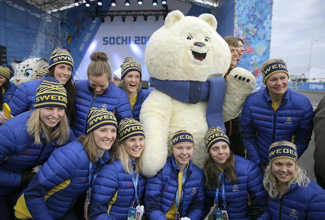 Members of Sweden's Olympic team pose with an Olympic mascot after their welcome ceremony ahead of the 2014 Winter Olympics, Wednesday, Feb. 5, 2014, in Sochi, Russia. (AP Photo/Vadim Ghirda)
