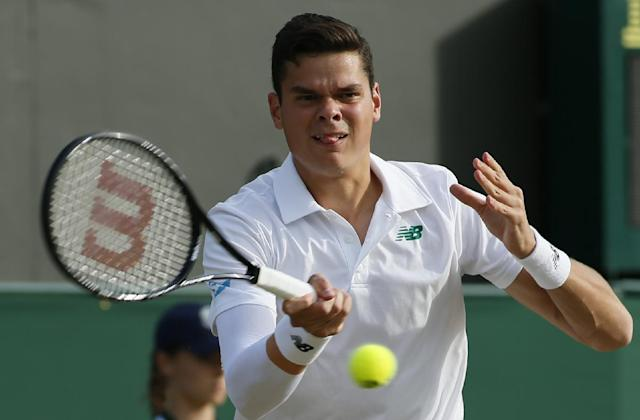 Milos Raonic of Canada plays a return to Lukasz Kubot of Poland during their men's singles match at the All England Lawn Tennis Championships in Wimbledon, London, Saturday, June 28, 2014. (AP Photo/Alastair Grant)
