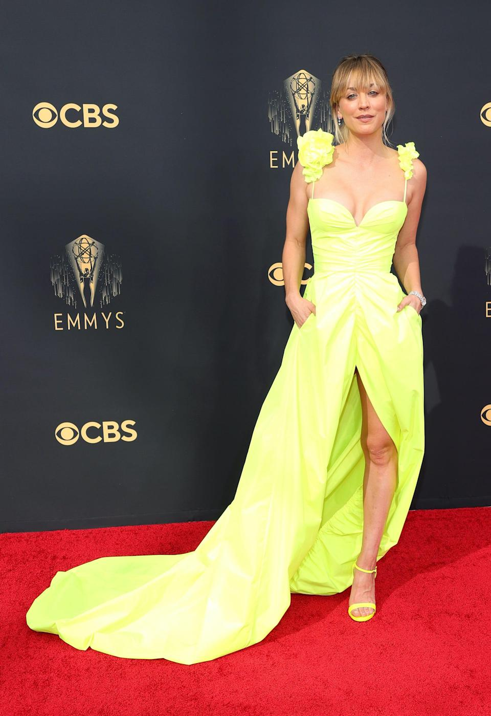 Kaley Cuoco wears a neon yellow dress on the Emmys red carpet.