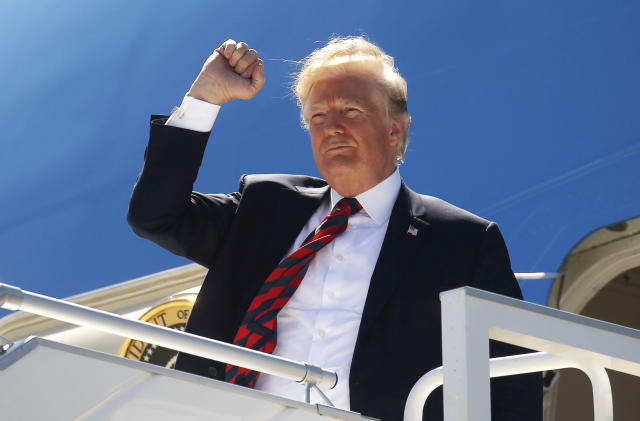 <p>President Donald Trump pumps his fist as he arrives to attend the nearby G7 Summit in Charlevoix after landing aboard Air Force One at Canadian Forces Base Bagotville in La Baie, Quebec, Canada, June 8, 2018. (Photo: Leah Millis/Reuters) </p>