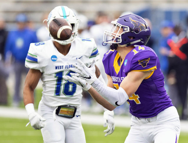 Minnesota State wide receiver Parker Gloudemans, right, catches a deep pass against West Florida defensive back Henry Montgomery, left, during the Division II championship NCAA college football game on Saturday, Dec. 21, 2019, in McKinney, Texas. (AP Photo/Gareth Patterson)