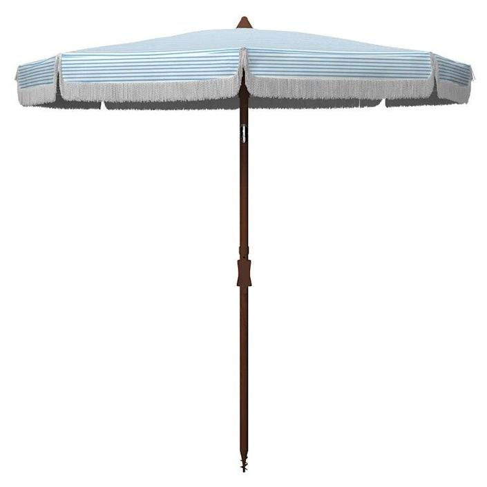 """For the modern minimalist, this pinstriped market umbrella (select from white/light blue, white/black, and white/navy) with white fringe tilts to your liking. $99, Wayfair. <a href=""""https://www.wayfair.com/outdoor/pdp/arlmont-co-mccammon-65-ft-umbrella-w004999997.html?piid=1004280129"""" rel=""""nofollow noopener"""" target=""""_blank"""" data-ylk=""""slk:Get it now!"""" class=""""link rapid-noclick-resp"""">Get it now!</a>"""
