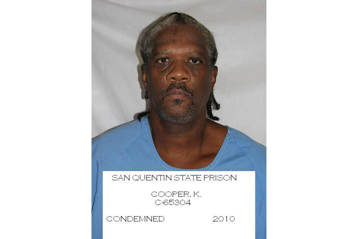 FILE - This undated file photo provided by the California Department of Corrections and Rehabilitation shows inmate Kevin Cooper. Gov. Gavin Newsom has ordered an independent investigation into the conviction of death row inmate Kevin Cooper, who claims he was framed for the stabbing deaths of four people, including two children, in 1983. Newsom on Friday, May 28, 2021, ordered a law firm to examine all the evidence, including results of DNA testing that Cooper had argued could prove his innocence. Newsom said he's taking no position on Cooper's guilt or innocence. Cooper wants clemency, alleging he was framed for a 1983 knife and hatchet attack on a Chino Hills family that killed four people, including a boy and girl, ages 10 and 11. (California Department of Corrections and Rehabilitation via AP, File)