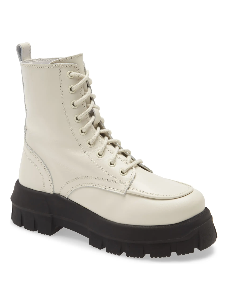 """Pair this lace-up white style with sweatpants and jeans for winter, then swap in skirts and dresses for a grunge-inspired juxtaposition come spring. $180, Nordstrom. <a href=""""https://www.nordstrom.com/s/topshop-ava-platform-combat-boot-women/5744441"""" rel=""""nofollow noopener"""" target=""""_blank"""" data-ylk=""""slk:Get it now!"""" class=""""link rapid-noclick-resp"""">Get it now!</a>"""