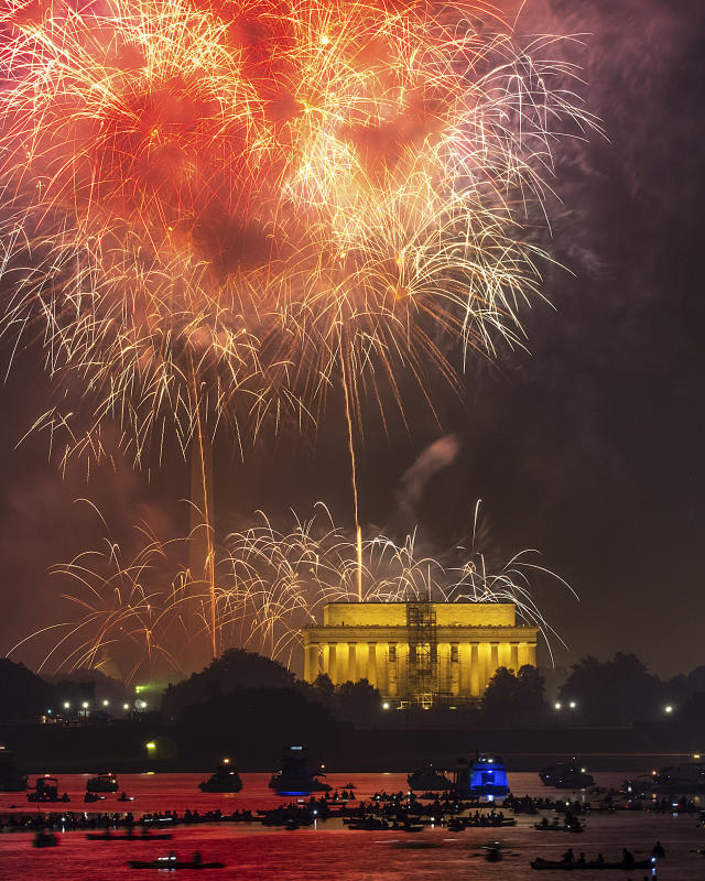 <p>Boaters on the Potomac River in Washington watch the fireworks display on the National Mall Wednesday, July 4, 2018, in celebration of Independence Day. (Photo: J. David Ake/AP) </p>