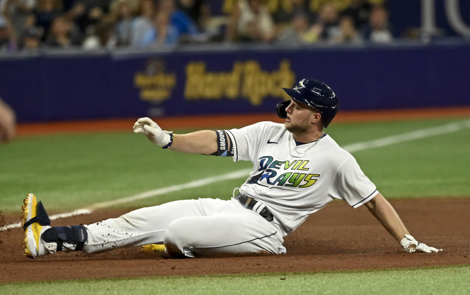 Tampa Bay Rays' Austin Meadows slides into third base with a triple off Miami Marlins' Sandy Alcantara during the fourth inning of a baseball game Saturday, Sept. 25, 2021, in St. Petersburg, Fla. (AP Photo/Steve Nesius)