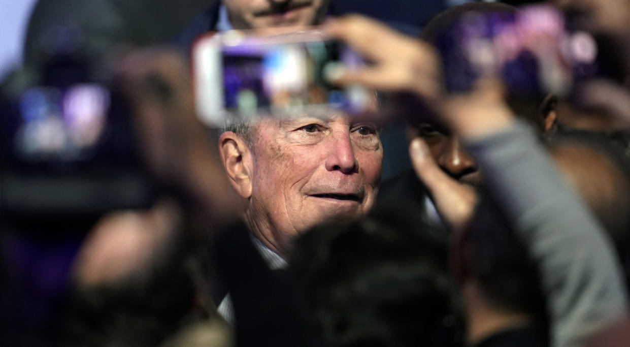 """Mike Bloomberg poses for photographs with supporters during his campaign launch of """"Mike for Black America"""" in Houston on Thursday. (AP Photo/David J. Phillip)"""