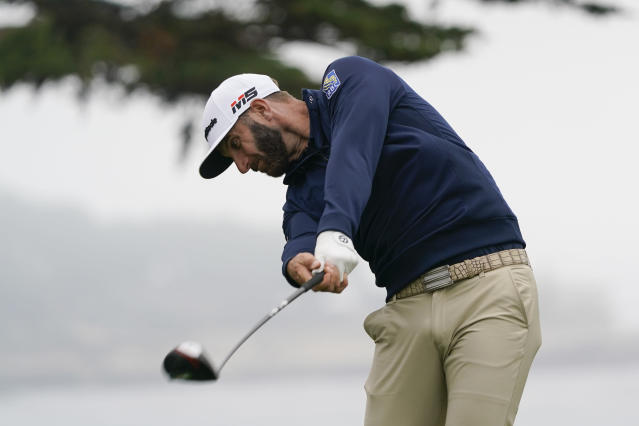 Dustin Johnson hits his tee shot on the 11th hole during a practice round for the U.S. Open Championship golf tournament Wednesday, June 12, 2019, in Pebble Beach, Calif. (AP Photo/David J. Phillip)