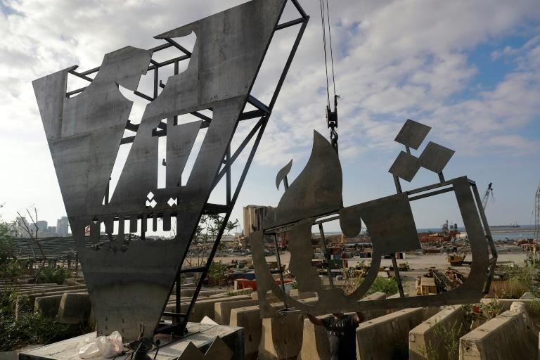 Lebanese activists erect a monument close to the site of a devastating August explosion in Beirut port to mark the first anniverary of nationwide protests for sweeping political reform