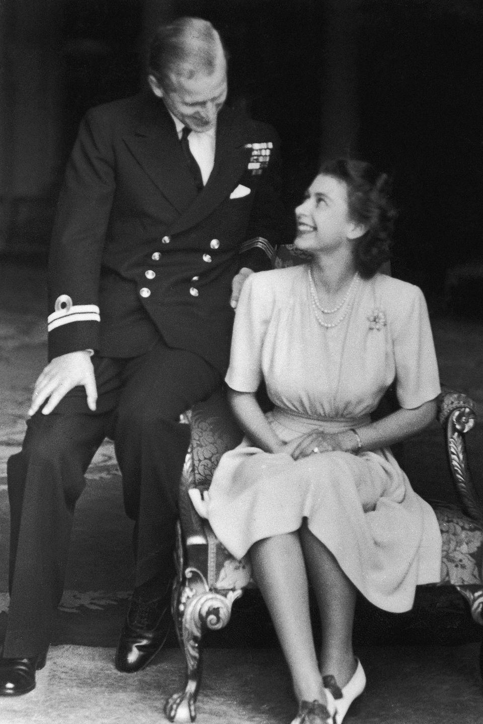 <p>Princess Elizabeth with her fiance, Philip, at Buckingham Palace after announcing their engagement in the summer of 1947. </p>