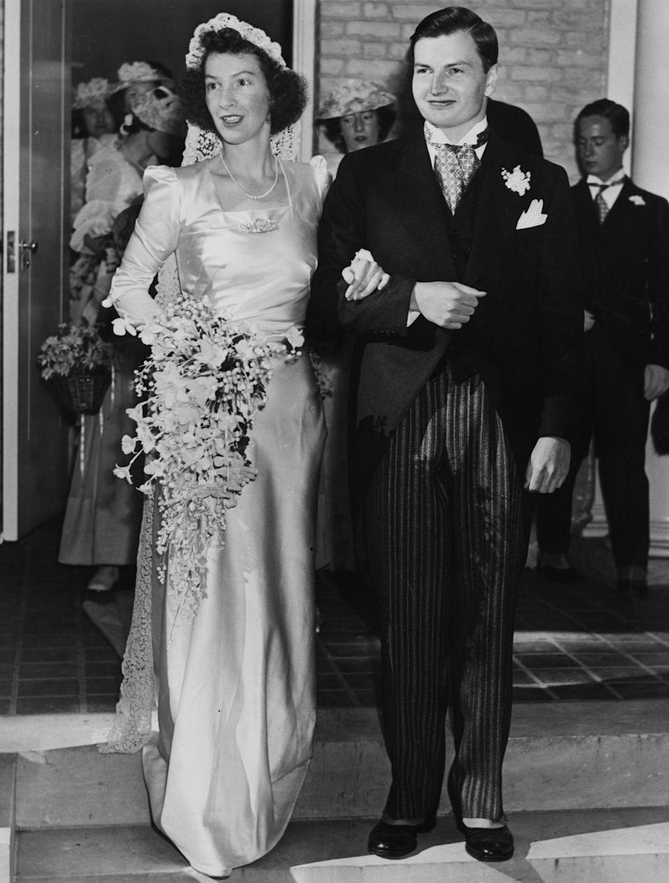 """<p>Almost ten years later in Bedford, NY, in 1940, his brother David Rockefeller (later the former chairman of the Chase Manhattan Bank and the Metropolitan Museum of Art) married Margaret McGrath and she wore a very similar gown—with slightly puffier sleeves. This, following a proposal made with a 5.6 carat rectangular step-cut <a href=""""https://www.christies.com/features/Live-like-a-Rockefeller-A-Raymond-Yard-engagement-ring-8926-1.aspx"""" rel=""""nofollow noopener"""" target=""""_blank"""" data-ylk=""""slk:diamond ring"""" class=""""link rapid-noclick-resp"""">diamond ring</a>. </p><p>Random aside that has literally nothing to do with the Rockefellers: Bedford is where Blake Lively and Ryan Reynolds currently live. </p>"""