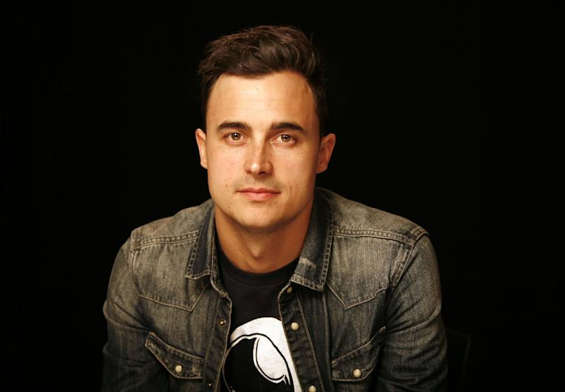 "This April 4, 2013 photo shows guitarist Joe King from the band, The Fray, in New York. After listening to ""Need a Girl By Friday,"" King said that U2 frontman Bono told him in an email: ""I need a song like this every Friday."" ""It's just encouraging to get that kind of response from people you respect and look up to,"" King said. His relationship with the band started a few years ago when The Fray opened up for U2 during their last tour. (AP Photo/John Carucci)"