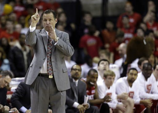 North Carolina State head coach Mark Gottfried calls a play in the first half of an NCAA college basketball game against Maryland in College Park, Md., Wednesday, Jan. 16, 2013. (AP Photo/Patrick Semansky)