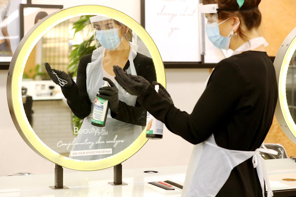 Senior stylist Lauren Roads demonstrates cleaning procedures for styling utensils, one of several potential workplace safety measures at Gatsby and Miller, Amersham, whilst waiting for future UK government guidelines regarding the reopening of salons.