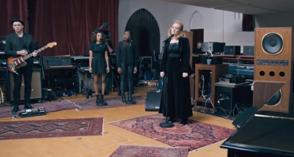 """<p>Not the traditionally produced music video, for the second song released from her upcoming album <i>25, </i>Adele performed """"When We Were Young"""" in a fashion-forward ensemble. Singing about past love in The Church Studios, she belted out the all-too-relatable lyrics while wearing velvet culottes (or maybe they're flood pants?) with Louboutin steel-toe boots, the same pair she wore for a recent outing, a black lacy camisole, and a velvet blazer. She had her hair in a half-up, half-down and her signature beauty consisting of an exaggerated cateye, long eyelash extensions, and pointy nails. </p>"""