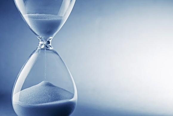 Hourglass against blue background