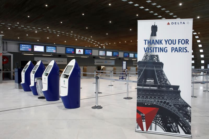 FILE PHOTO: American airlines company Delta registration desks are deserted at Paris Charles de Gaulle airport