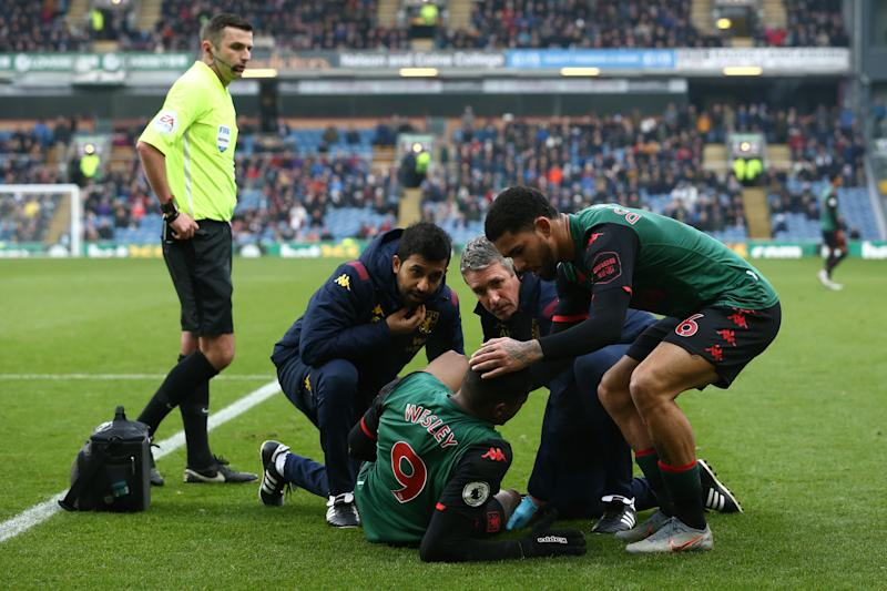 BURNLEY, ENGLAND - JANUARY 01: Wesley of Aston Villa receives medical attention during the Premier League match between Burnley FC and Aston Villa at Turf Moor on January 01, 2020 in Burnley, United Kingdom. (Photo by Jan Kruger/Getty Images)
