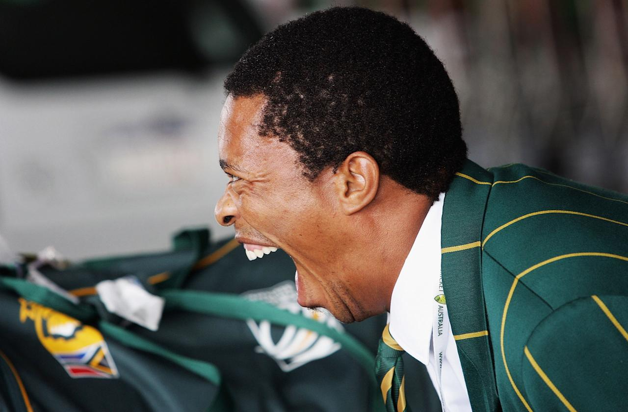 PERTH, AUSTRALIA - DECEMBER 03:  Makhaya Ntini of the South African cricket team shares a joke with team mates after arriving at Perth International airport December 03, 2005 in Perth, Australia.  (Photo by Paul Kane/Getty Images)