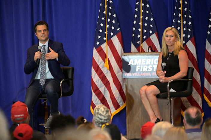 Rep. Matt Gaetz, R-Fla., and Rep. Marjorie Taylor Greene, R-Ga., address attendees during a rally May 7 in the Villages, Fla.