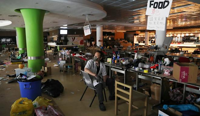 "A young man commonly known as ""the chef"" was one of the few people left on the PolyU site. Photo: Reuters"