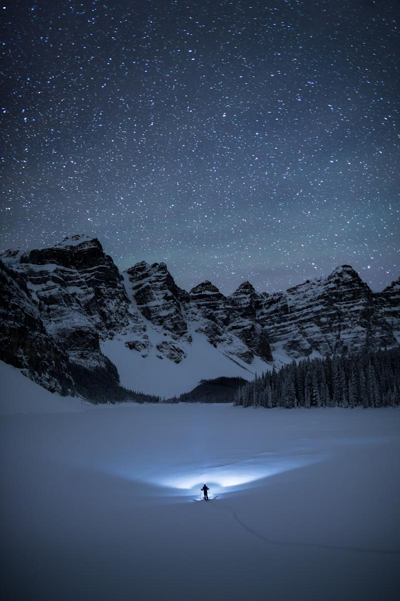 One of Pauls amazing self portraits. at Moraine Lake, Canada. (Photo: Paul Zizka/Caters News)