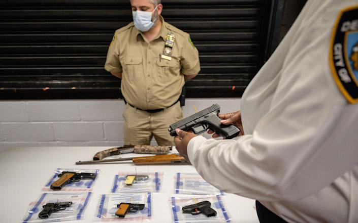 A Glock 17 pistol, or handgun, is displayed during a gun 'buyback' event held by the New York Police Department (NYPD) - AFP