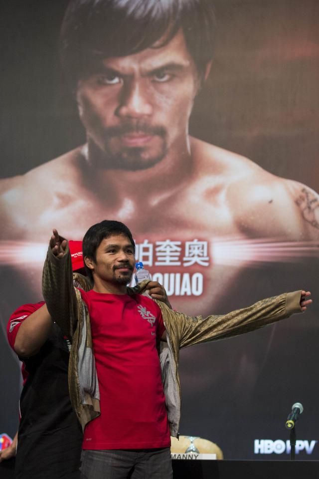 Filipino boxer Manny Pacquiao wears a jacket after a news conference at the Venetian Macao hotel in Macau November 20, 2013. Pacquiao will fight against American Brandon Rios in a 12-round welterweight clash on November 24. REUTERS/Tyrone Siu (CHINA - Tags: SPORT BOXING)