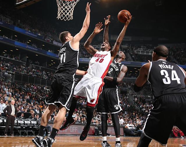 NEW YORK, NY - NOVEMBER 1: Udonis Haslem #40 of the Miami Heat goes up to shoot against Brook Lopez #11 of the Brooklyn Nets during a game at Barclays Center on November 1, 2013 in the Brooklyn borough of New York City. (Photo by Nathaniel S. Butler/NBAE via Getty Images)