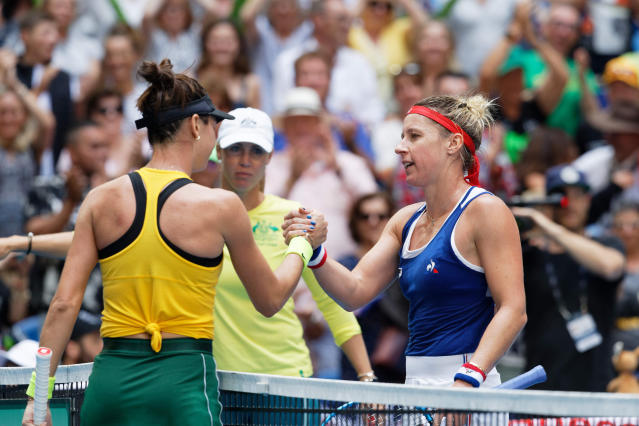 Australia's Ajla Tomljanovic shakes hands with France's Pauline Parmentier after their Fed Cup tennis final in Perth, Australia, Sunday, Nov. 10, 2019. (AP Photo/Trevor Collens)