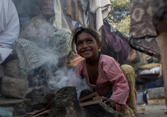 <p>A Pakistan girl tries to light fire on a makeshift stove for cooking outside her shanty home in Karachi, Pakistan, Feb. 12, 2015. (AP Photo/Shakil Adil) </p>