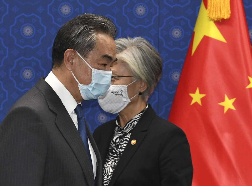 South Korean Foreign Minister Kang Kyung-wha, right, and Chinese Foreign Minister Wang Yi, arrive for their meeting at the foreign ministry in Seoul, South Korea, Thursday, Nov. 26, 2020. Wang arrived in Seoul on Nov. 25, for a three-day state visit.(Kim Min-hee/Pool Photo via AP)