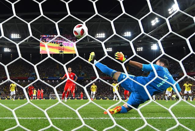 <p>Harry Kane of England scores the opening goal from a penalty past David Ospina of Colombia during the 2018 FIFA World Cup Russia Round of 16 match between Colombia and England at Spartak Stadium on July 3, 2018 in Moscow, Russia. (Photo by Mike Hewitt – FIFA/FIFA via Getty Images) </p>