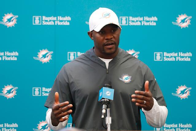 Miami Dolphins head coach Brian Flores speaks to members of the media before the start of practice at the NFL football team's training camp, Monday, Aug. 19, 2019, in Davie, Fla. Ryan Fitzpatrick is expected to start the Miami Dolphins' exhibition game this week, which suggests he's still the front-runner in his battle with Josh Rosen for the starting job. (AP Photo/Wilfredo Lee)