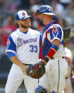 Atlanta Braves relief pitcher A.J. Minter (33) celebrates a victory with catcher Tyler Flowers at the conclusion of a baseball game against the Baltimore Orioles, Sunday, June 24, 2018, in Atlanta. (AP Photo/Todd Kirkland)