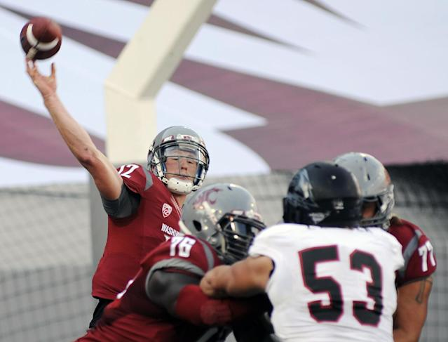 Washinton State quarterback Connor Halliday throws against Southern Utah in the first half of an NCAA college football game, Saturday, Sept. 14, 2013, in Pullman, Wash. (AP Photo/Rajah Bose)