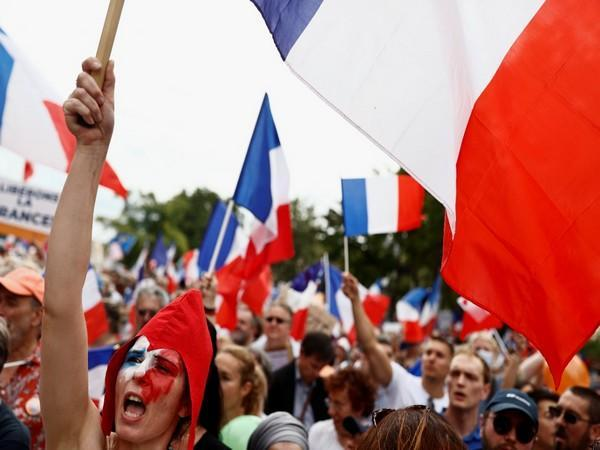 Protesters attend a demonstration against France's restrictions, including a compulsory health pass, to fight the coronavirus disease (COVID-19) outbreak, in Paris, France on Saturday.