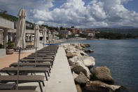Beach loungers are set for tourists in Opatija, Croatia, Saturday, May 15, 2021. Croatia has opened its stunning Adriatic coastline for foreign tourists after a year of depressing coronavirus lockdowns and restrictions. (AP Photo/Darko Bandic)