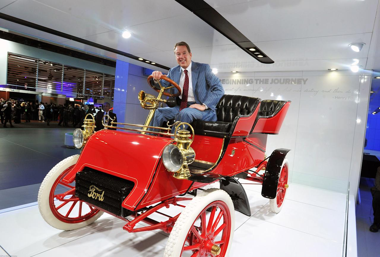 Ford chairman Bill Ford Jr. sits in the oldest surviving Ford vehicle, a 1903 runabout, built by his great-grandfather Henry Ford.