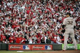 Reds fans wave anything they can find as Ryan Vogelsong prepares to pitch. (AP)